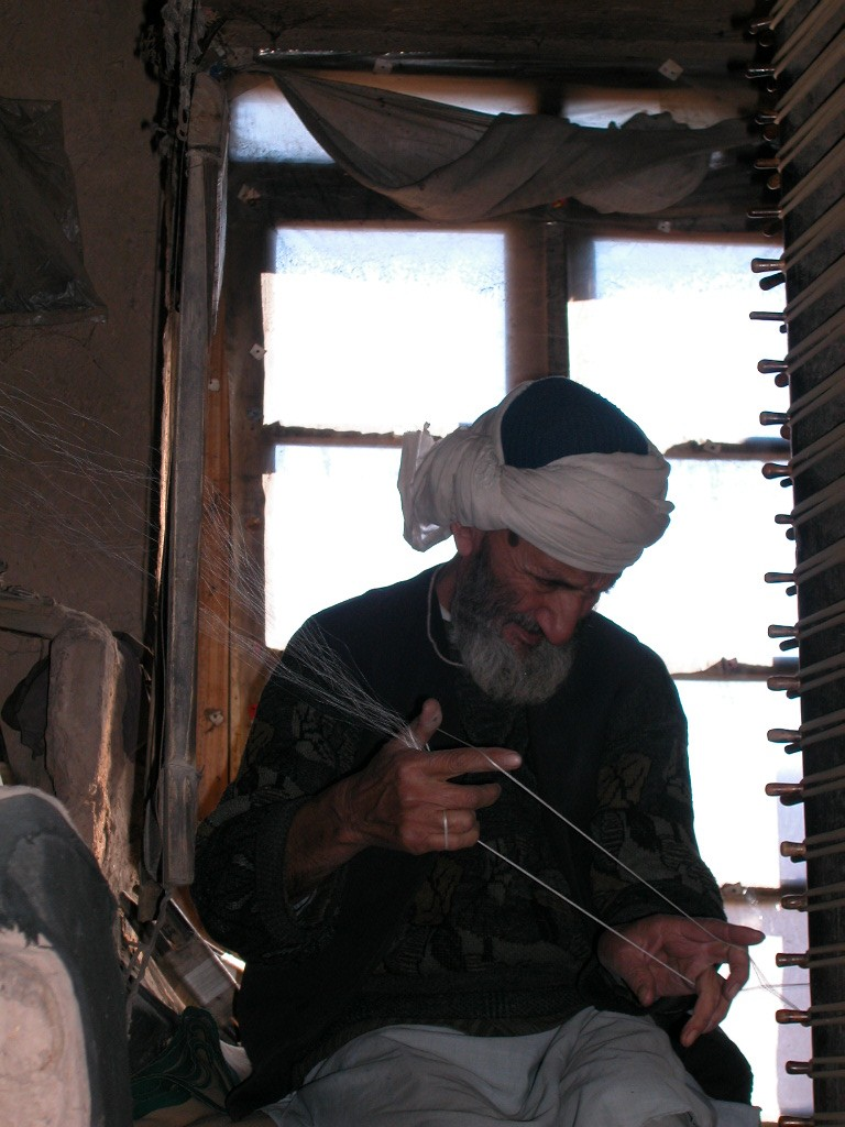 Arghand artisan is reeling silk yarn