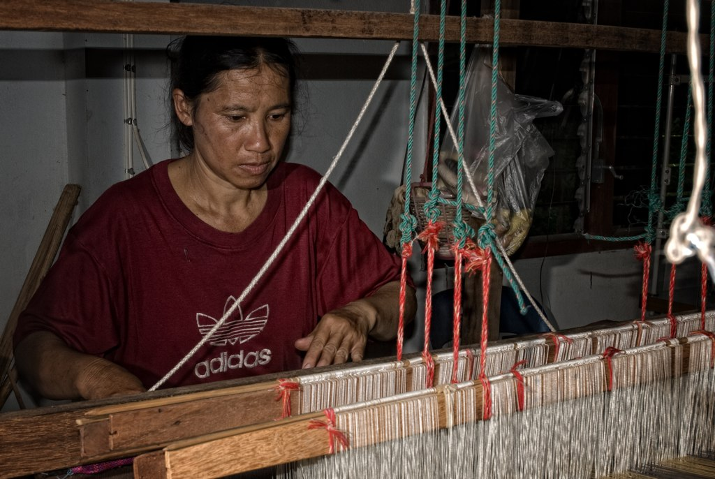 Artisan from Pa Daeng is weaving a cotton shawl